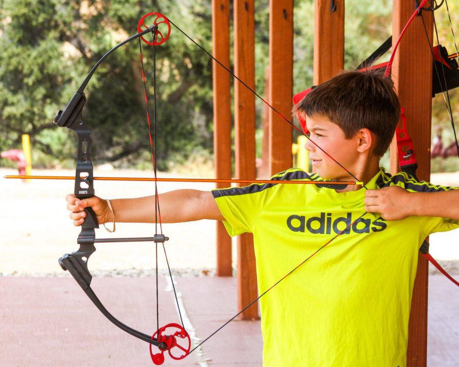 Camper taking archery lessons