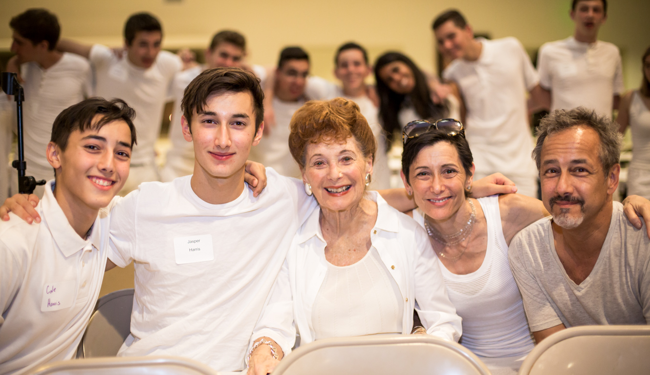 Campers and family dressed in white for shabbat