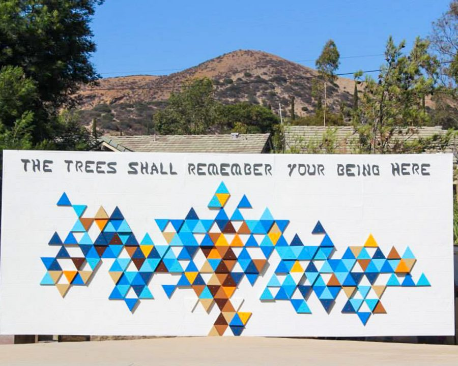 "Art mural that says ""The trees shall remember your being here"""