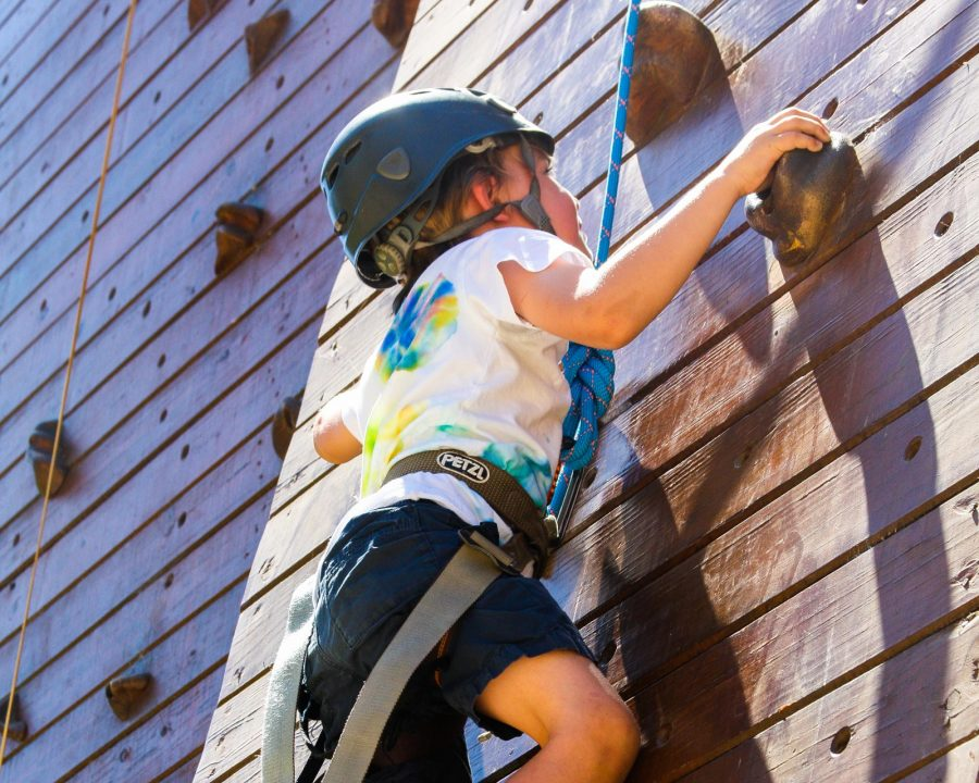 Camper climbing the rock wall