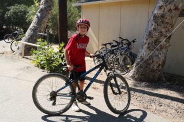 camper riding a bike